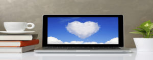 Heart in clouds on laptop screen